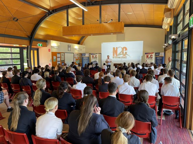 Warren Luff speaking to the students at Assisi Catholic College